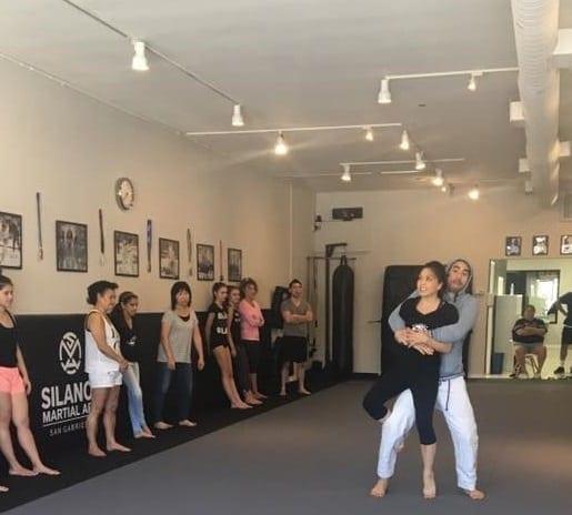 Professor Gino and his assistent Anna showing a Self-Defense technique at the Self-Defense seminar