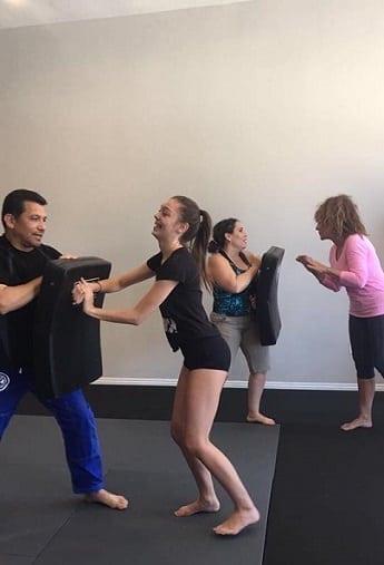 Students helping at the Jiu-Jitsu Self-Defense Seminar