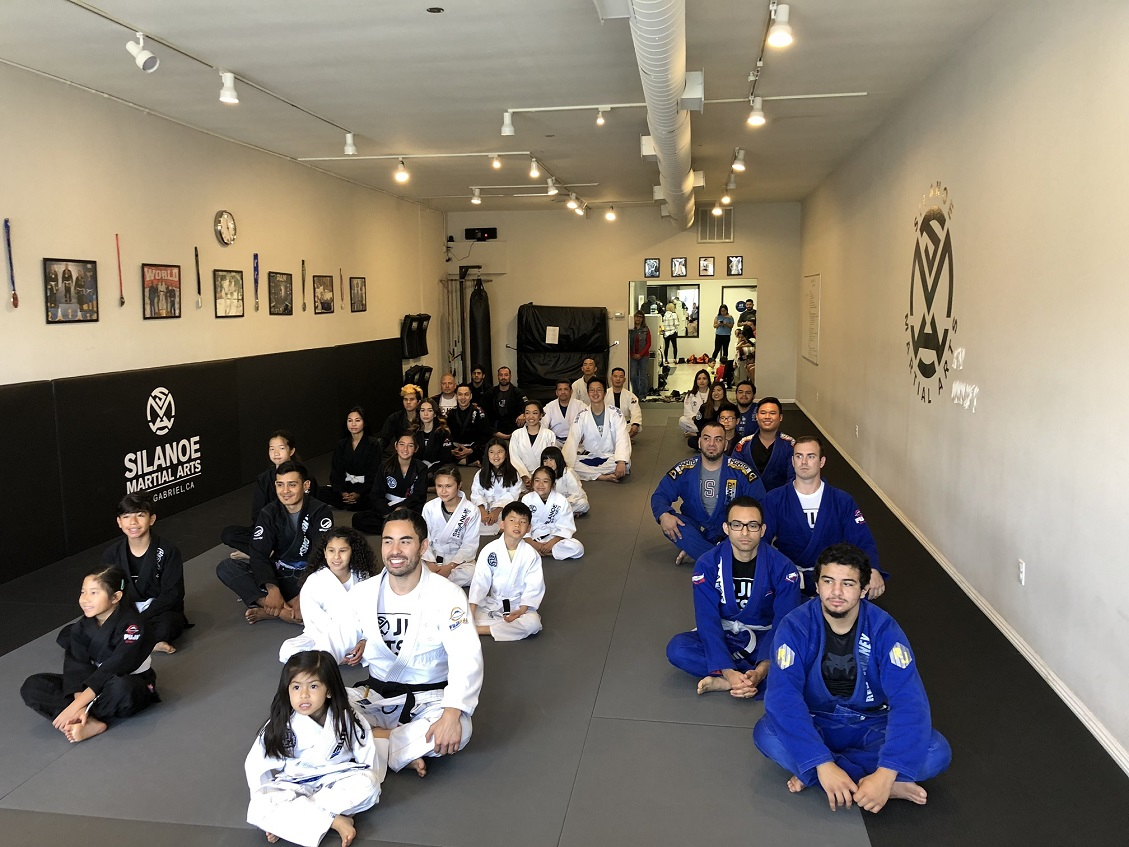 Professor Gino with the Jiu-Jitsu kids and adults at the belt promotion ceremony