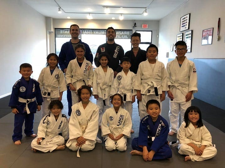 A group photo of the kids in the Silanoe Martial Arts Jiu-Jitsu kids program where they learn self-defense and how to protect against bully