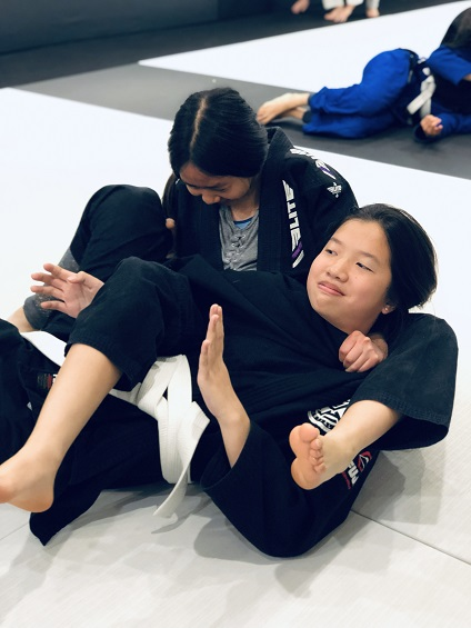 Teen Jiu-Jitsu student Faith trains with Sandra at Silanoe San Gabriel Alhambra