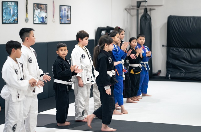 Jaelen in a group picture at the Silanoe Martial Arts belt promotion ceremony together some of his Kids 2 teammates.