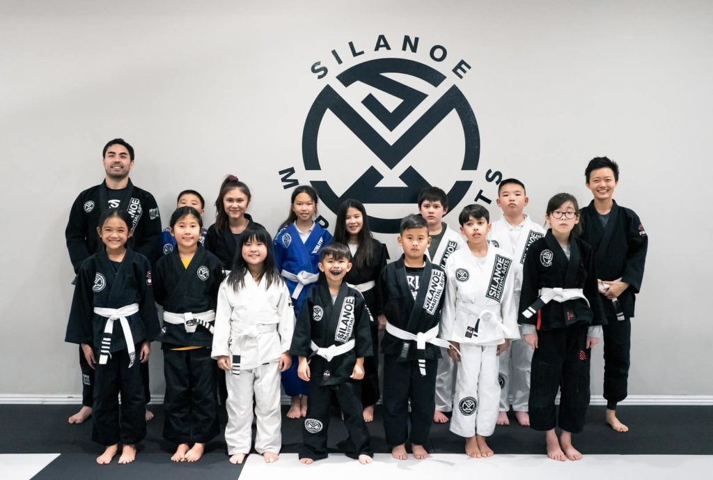 Bella together with fellow Kids 2 BJJ students in a group picture