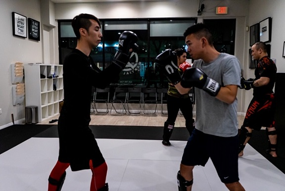 Ivan training with Denny at the Muay Thai Kickboxing class