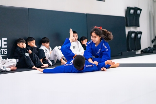 Student of the Month Bella K. Jiu-Jitsu sparring with Kyle in Kids program at Silanoe Alhambra