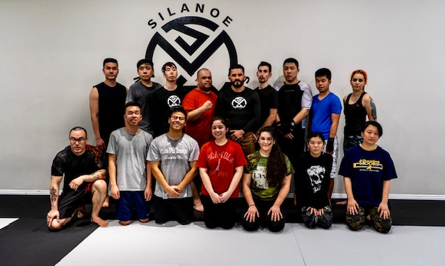 Joe Hernandez in the red shirt in a Group Picture with Muay Thai Kickboxing teammates