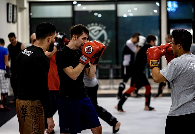 Paul Rocha in the Muay Thai Kickboxing striking class at Silanoe Martial Arts in San Gabriel