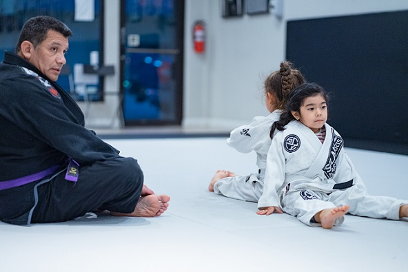 Coach Chris teaching Lola and Chelsea of Kids 1 Martial Arts BJJ Program ages 5-8