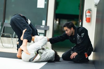 Professor Gino correcting the teens and adults in the Fundamentals BJJ Class